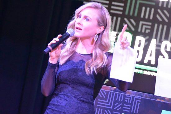 Courtney Brennan emceeing an event